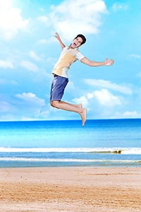 Indina Teenage Boy Jumping Beach Shouting