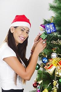 Woman Festival decorating Christmas tree Smiling