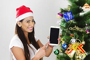 Woman Christmas Tree Celebrating Showing Cellphone