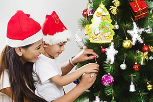 Indian Mother Child Son decorating Christmas tree