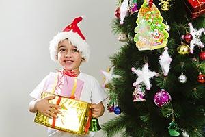Happy Child boy presents gift celebration Christma