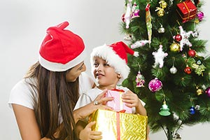 Indian Son Receiving Christmas Gift Mother Smiling
