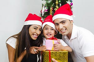 Happy Son Receiving Christmas Gift Parents Celebra