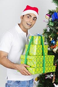 Man Presents Gifts Christmas Celebration Smiling