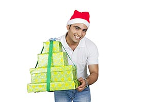 Indian Man Wrapped gift box Showing Christmas Fest