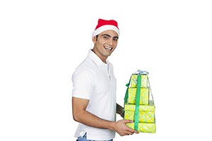 Happy Man Wrapped gift box Showing Christmas Festi