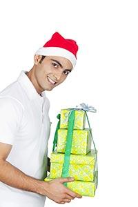Man Wrapped gift box Showing Christmas Celebration