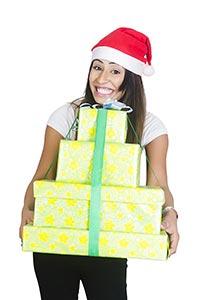 Woman Wrapped gift box Showing Christmas Celebrati