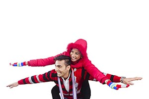 couple winter clothes playing piggyback Fun Excite