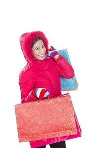 retail and sale concept happy woman winter clothes