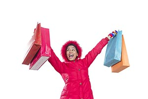 Excited Woman Winter Clothe carrying Shopping Bags