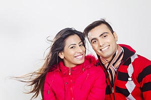 Smiling couple in winter clothes Enjoy