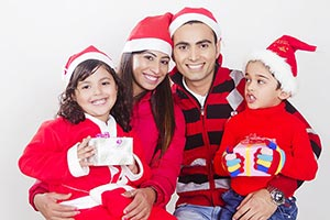 Indian Family Christmas Gifts Celebration Smiling