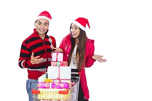 Excited Couple christmas shopping gift Trolley Fun
