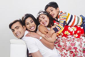 Parents Kids Lying Sofa At Home Enjoy Smiling
