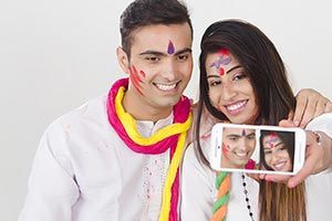 Couple Holi Celebrating Enjoying Taking Selfie pic
