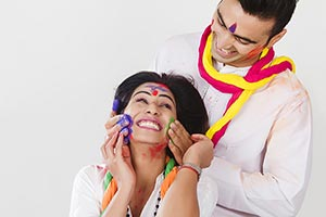 Couple Holi Celebrating Enjoying applying Colour R