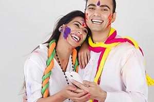 Indian Couple Holi Celebrating Fun Chatting Phone