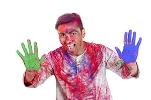 Shouted Man showing colourful palm celebrating hol