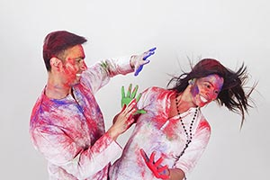 Couple colored hands Holi Celebrating Fun Applying