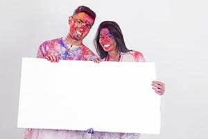 Indian Couple Holi Celebrating Showing Message Boa