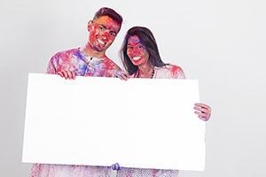 Indian Couple Holi Celebrating Showing Message Boa