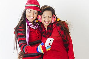 2 Young Woman Friend Winter Clothes Sharing Readin