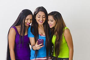 Young Womens Friends Sharing Reading Text Message