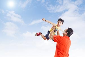 Kid Son lifting Father