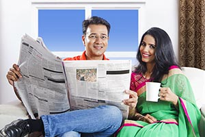 Married Couple Reading Newspaper