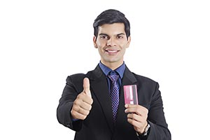 Businessman Showing Credit card Thumbsup