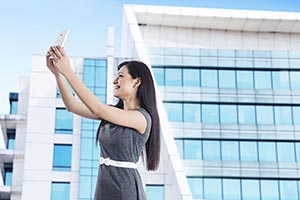 Businesswoman Taking Selfie Office Building