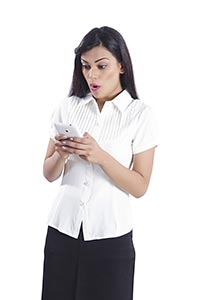 Shocked Businesswoman Reading Message  Phone