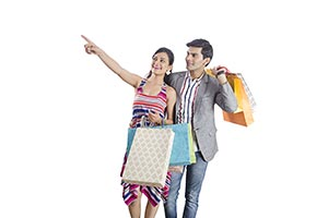 Couple Pointing Shopping Bags