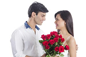 Romantic Couple Giving Flowers