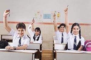 School Students Classroom  Hand Raised