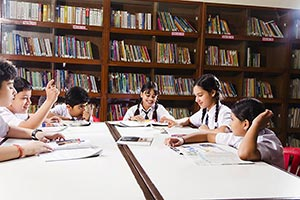School Students Studying Library