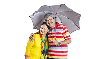 Senior Couple Under Umbrella