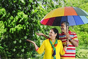 Senior Couple Rain Umbrella