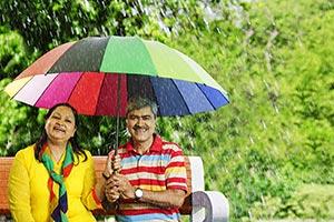 Senior Couple Under Umbrella Rain