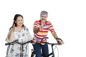 Senior Couple Riding Bicycle Thumbsup