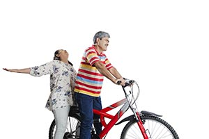 Romentic Senior Couple Riding Bicycle