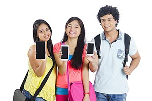 Teenage  College Friends Showing Smartphone