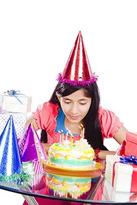 Teenage Girl Blowing Birthday Candles