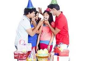 Friends Feeding Girl Cake Birthday