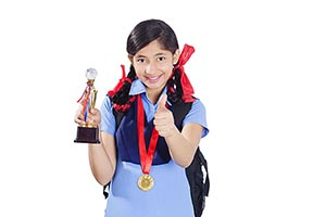 Indian School Girl Winning Trophy Medal Thumbsup