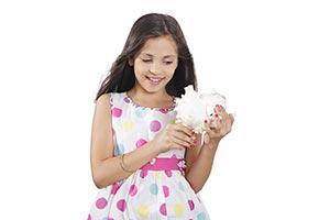 Indian Little Girl Holding Shell