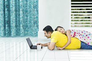 Father Daughter Using Laptop