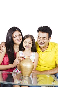 Parents Daughter Inserting Coin Piggybank