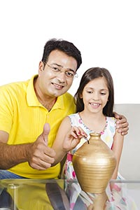 Father Daughter Putting Coin Piggybank Thumbsup